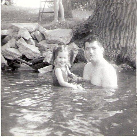 Daughter Lynn and me swimming in the Fox River at my Mom's Home on the river in Berlin, WI